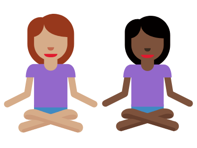 image of two girls sitting in a yoga pose