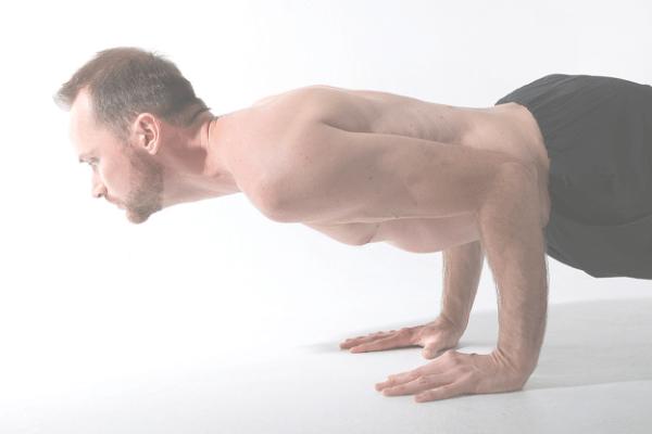 image of intermediate yoga pose chaturanga